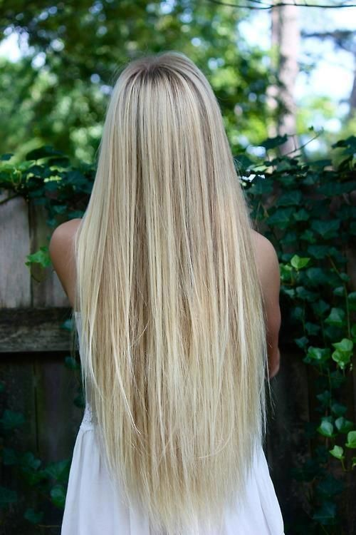 long silky straight blonde hair, my color is only slightly darker than this and my length is only about 5 inches shorter