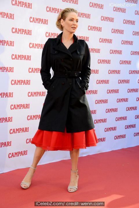 Uma Thurman  ( Uma Thurman looking classy in Versace dress at the 2014 Campari Calendar launch) See more pic... http://www.icelebz.com/events/uma_thurman_looking_classy_in_versace_dress_at_the_2014_campari_calendar_launch/
