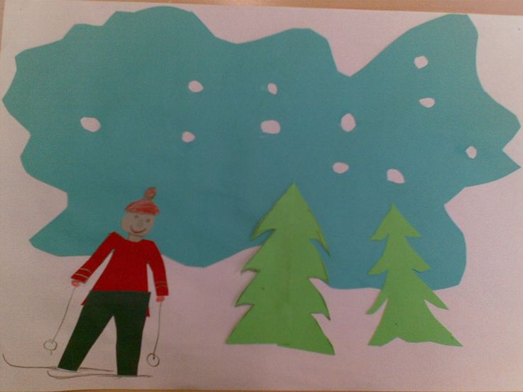 """""""Talvi"""" (1.-2.lk) Väripaperista leikatut kuuset, taivas, lumihiutaleet ja hiihtäjä on liimattu valkoiselle paperille."""