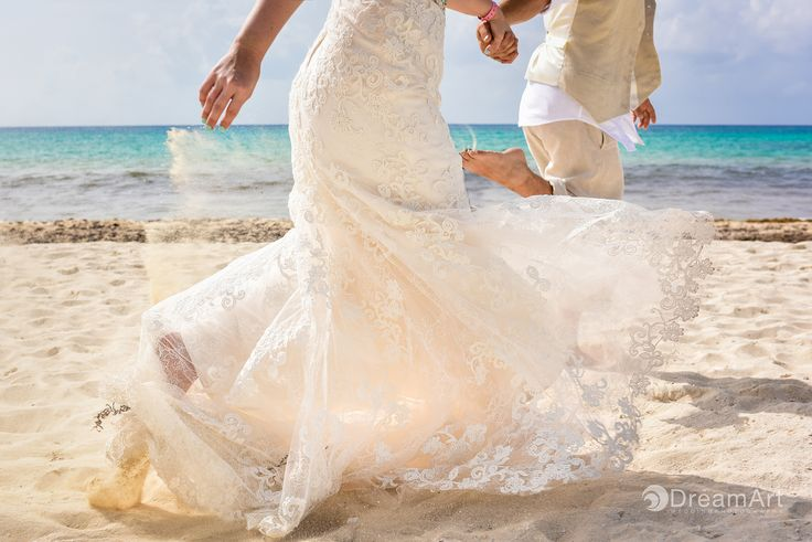 Bride and Groom Running on their Wedding Photography Session. Moment captured by #DreamArtPhotography at Playacar Palace @palaceresorts #DreamArtWeddings #WeddingPhotography #Wedding #Photography #Bride #Groom #WeddingDress #Running #Beach #RivieraMaya #Mexico