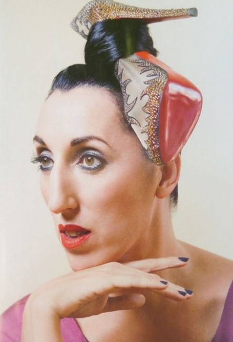 """""""Oh, you know, just sitting here with a shoe tied in my hair"""" (Spanish actress Rossy de Palma, muse of Pedro Almodovar cinema director.)"""