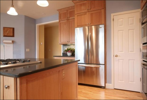 Light blue walls with maple cabinets dark countertops and for Beaverton kitchen cabinets reviews