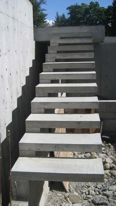 exterior concrete cantilevered stair frontal overview more