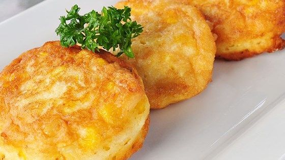 Celebrate the arrival of fresh sweet corn by making a batch of light and delicate corn fritters. Serve drizzled with cane syrup or maple syrup for a breakfast treat or as a side dish with ham or ribs.