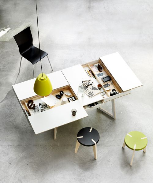 Table with multiple storage compartments