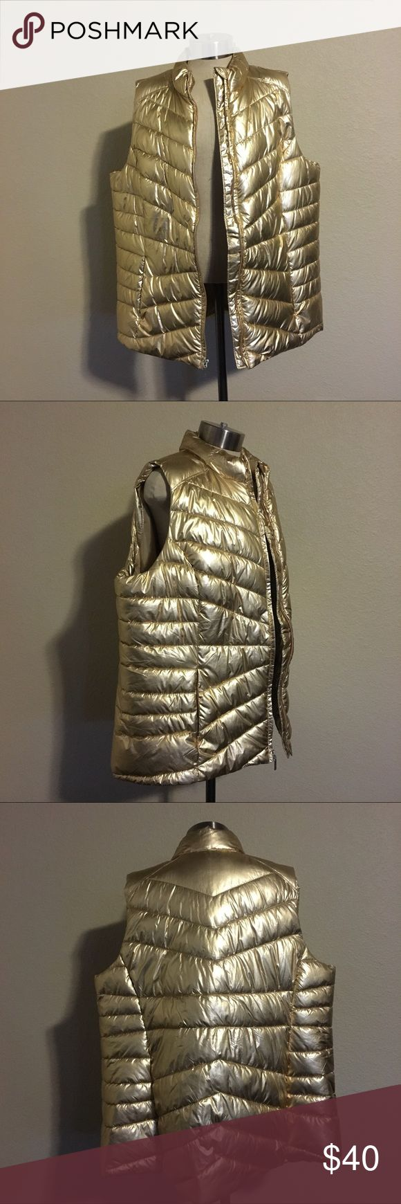 """Layne Brant Livi Active metallic vest Flat lay measurements bust 26"""", length 30"""" front, 32"""" back. NWT. Gorgeous metallic vest in a gold hue! Pair it with a long sleeve and your favorite leggings for a glam look while you run errands, the options are endless! Lane Bryant Jackets & Coats Vests"""