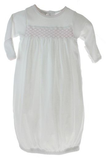 Soft pima cotton take home layette gown for baby girl features pink smocking across the chest and elastic hem to keep feet covered. Unique baby shower gift for newborn girl. Shop our online baby boutique for classic baby clothing and layette sets.
