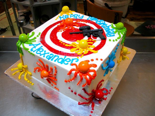 Square Paintball Themed Wicked Chocolate Cake Iced In White Er Icing Decorated With Piped Target Fondant Paint