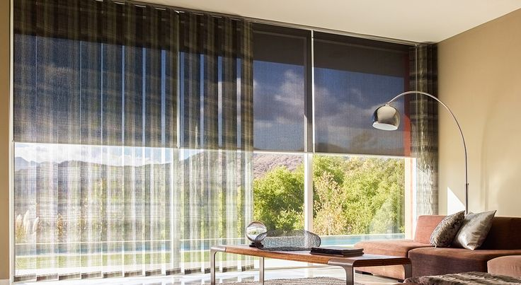 Beautiful XL Vertical Blinds effortlessly cover wide walls of windows Shown in material Plaid color Multi with Solar Shades in material color Black Simple Elegant - Unique types of blinds and shades Unique