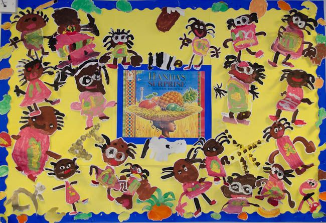 This eye-catching EYFS display links to the picture book 'Handa's Surprise'.