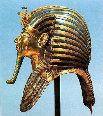 Golden mask of Tutankhamun- stripes snakes, longbeard, huge helmet-like headdress and shoulder plate