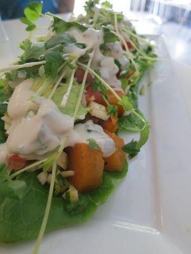 Nourish Naked Burrito: cos lettuce, roast vegetables, chunky salsa & topped with avocado, aioli, coriander and cashew sour cream AU$12.50: