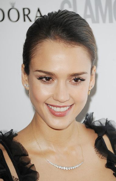Jessica Alba Classic Bun - By sweeping her hair back into a sophisticated bun, Jessica Alba kept the focus on her dewy complexion.