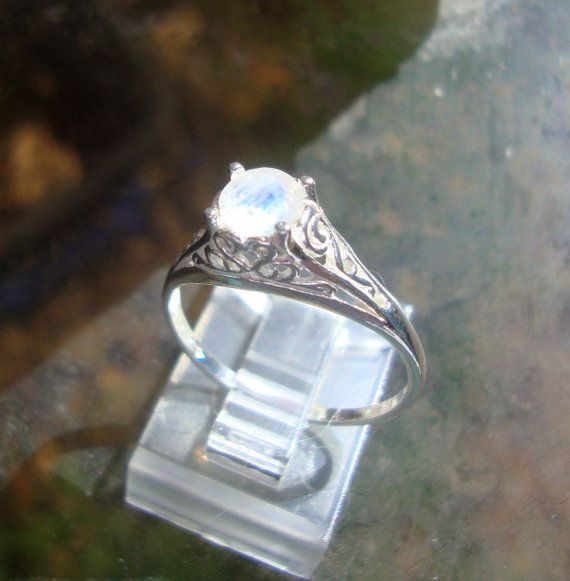 Filigree Ring sterling silver with rainbow moonstone $95.00, via Etsy.