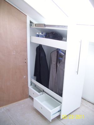 Awesome knee wall closet storage that can go deep into attic.