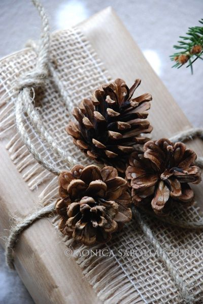 Create a natural look for Christmas gifts using kraft paper, burlap ribbon, natural twine and pinecones.