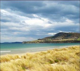 Stroll along Seven Mile Beach in Tassie
