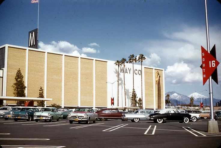 May Co (now known as Macy's) at the Eastland Center Mall, West Covina, California 1958. If you look to the right side of the photo you'll see Cucamonga Peak and Mt Baldy off in the distance.