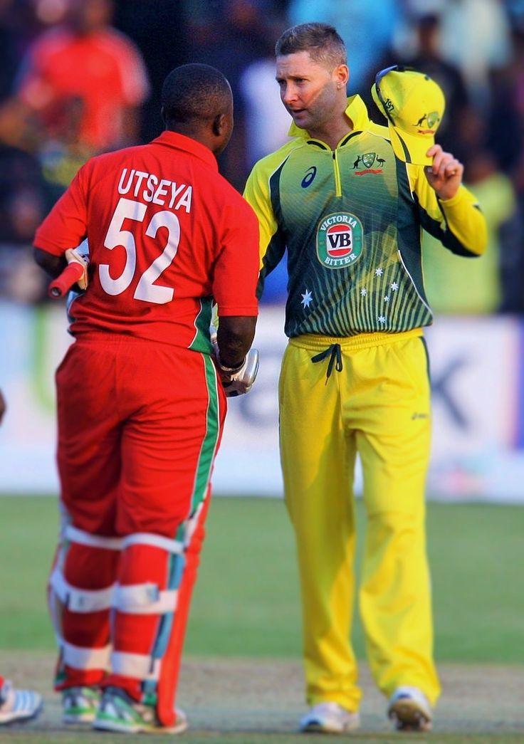 Australia captain Michael Clark shakes hands with Zimbabwe's Prosper Utseya at the end of a historic 3 wicket win against Australia  #ZimTriSeries #ZIvsAUS