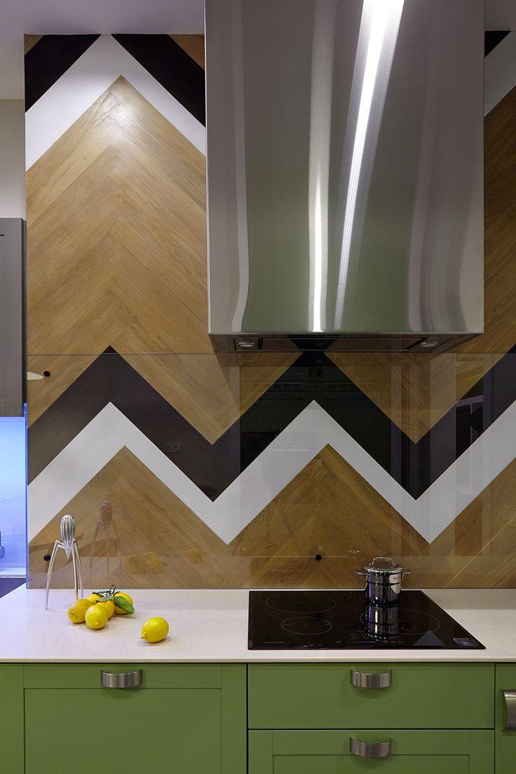 really sleek  range hood -  back splash mimicking living room's herringbone hardwood floors for an unusual