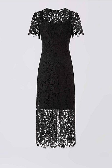 This sleek lace column dress in a sophisticated hue is perfect for fall weddings. It comes with a separate cotton slip and a high back slit for ease of movement.