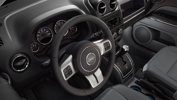 2013 Jeep Patriot. Reach out and experience soft-touch materials (Limited model shown).  www.naplesdodge.com