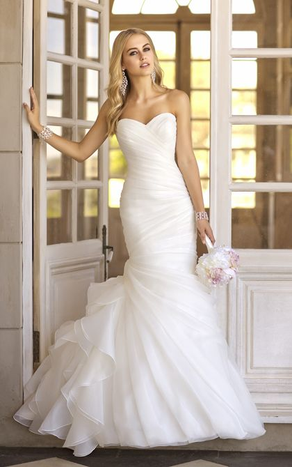 This trumpet designer vintage wedding gown features asymmetrical Organza pleats throughout its beautiful bodice and skirt, while fun and flirty gathered fabric on the side hints at vintage charm to truly make these trumpet wedding dresses shine.