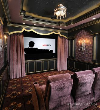 Movie night done right: personal viewing room in gold and wine. Fresco walls match the carpet. Ambient lighting and plush seats. Gold detailing on the crown molding, paneling and cabinets.  Interior Design: Jane Page Design Group