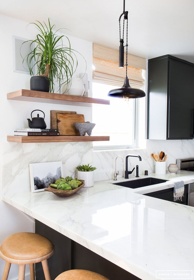 great kitchen styling idea - marble countertop and backsplash, exposed open shelving, black cabinets
