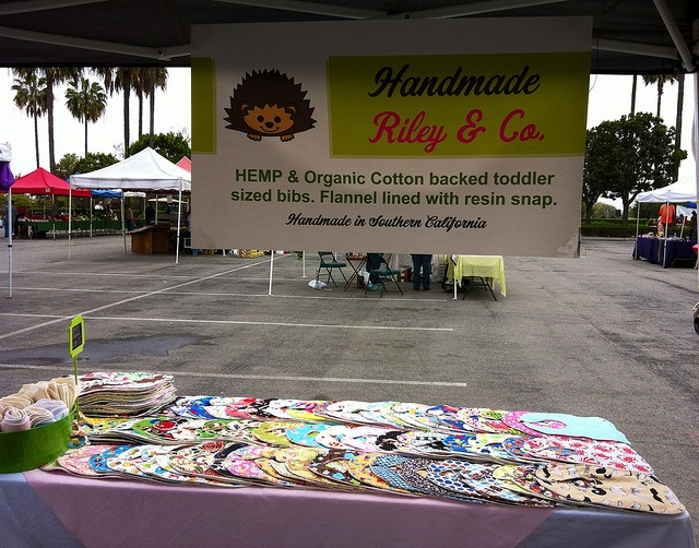 Great booth sign! rileyandco Organic Cotton & Hemp bibs craft show set up craft show booth