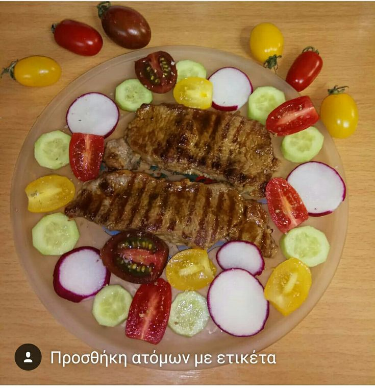 New York stake with zebra, yellow, red cherry tomatoes, cucumber and radish 😋