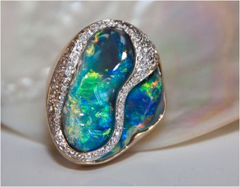 Black opal & diamond ring: freeform 24.28 carat black opal accented with (110) round brilliant-cut diamonds weighing .70, set in 18k yellow gold.
