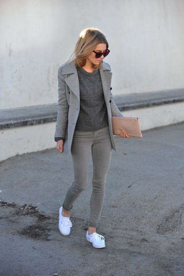 Stand out among other stylish civilians in a grey pea coat and grey skinny jeans. A pair of white low top sneakers will be a stylish addition to your outfit.  Shop this look for $165:  http://lookastic.com/women/looks/sunglasses-crew-neck-sweater-pea-coat-clutch-skinny-jeans-low-top-sneakers/5900  — Burgundy Sunglasses  — Charcoal Crew-neck Sweater  — Grey Pea Coat  — Beige Leather Clutch  — Grey Skinny Jeans  — White Low Top Sneakers