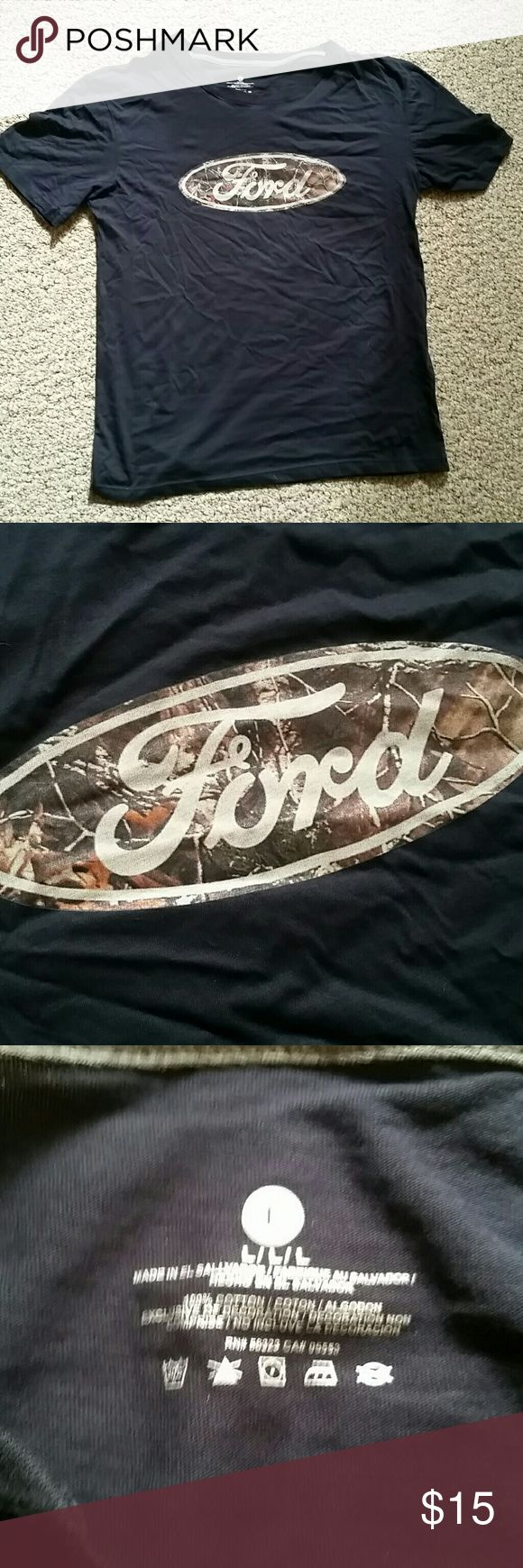 FORD tshirt brand new Black ford tshirt. Unisex, size large. Camo background behind the FORD sign. New, never worn. Sitting in back of the closet sense christmas. Offers accepted. Ford  Tops Tees - Short Sleeve