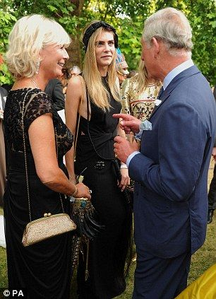 The Prince of Wales meets Pandora Delevingne (left), Cara Delevingne (centre).