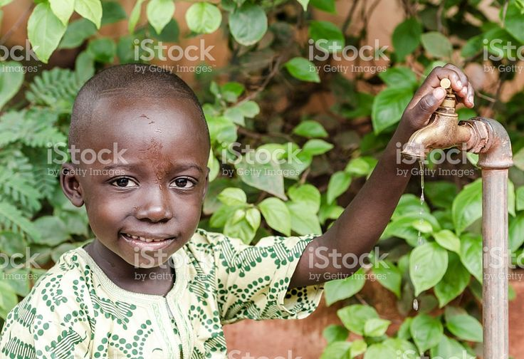African Black Boy Smiling for Fresh Clean Water royalty-free stock photo