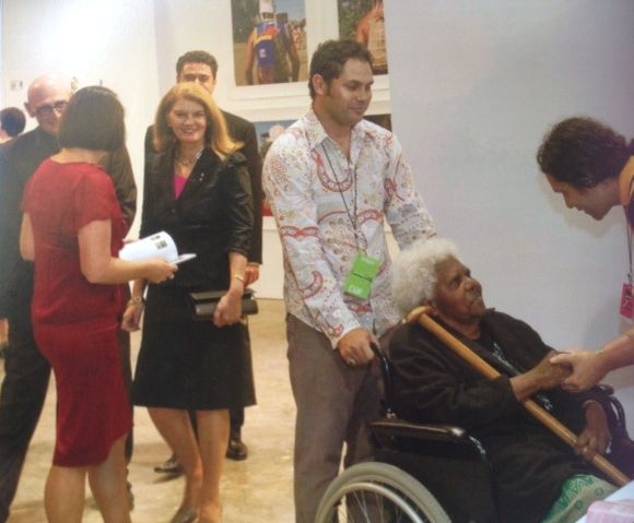 Thancoupie is being introduced to Tony Albert by the Arts Queensland Backing Indigenous Art Program manager Cameron Costello at the 2009 Cairns Indigenous Art Fair held at the Cairns Tanks Arts Centre:  photo courtesy Arts Queensland.