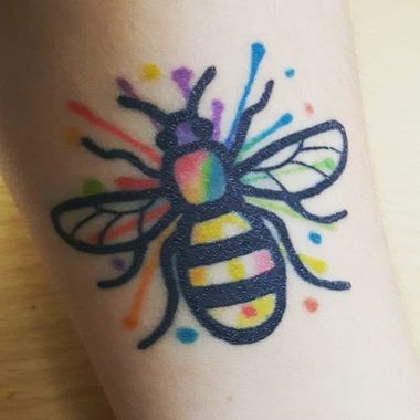 In darkness, there is always light. This worker bee tattoo shows the promise of a bright and colorful future for the people of Manchester.