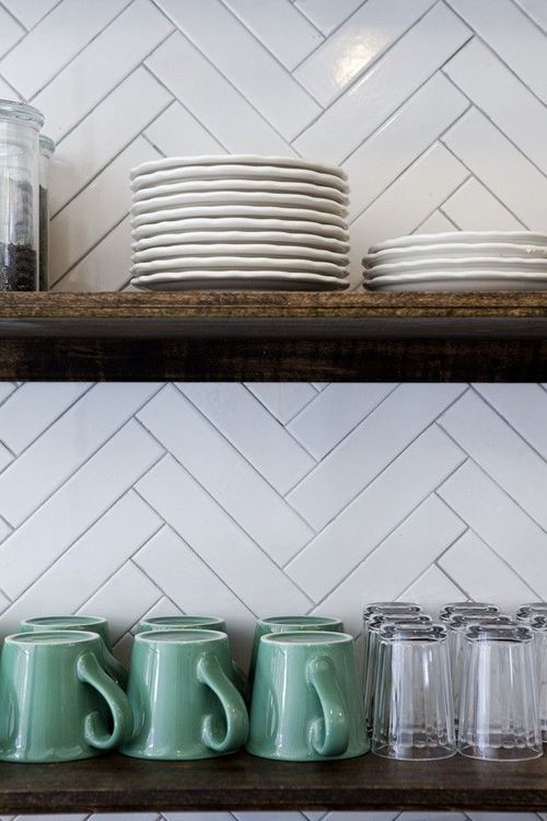 Kitchen; coffee mug; shelving; herringbone pattern backsplash | Interior Designer: Nicole Franzen / Image source: Remodelista