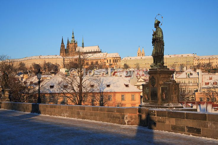 Prague Castle from the Charles Bridge with the statue of Saint John Nepomuk, Prague, Czech Republic