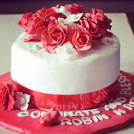 Wedding Cakes - Beautiful Red and White Liquor Cake with White Fondant and Red Sugar Flowers   All Things Yummy #allthingsyummy #fondant #wedding #cakes #sugarflowers