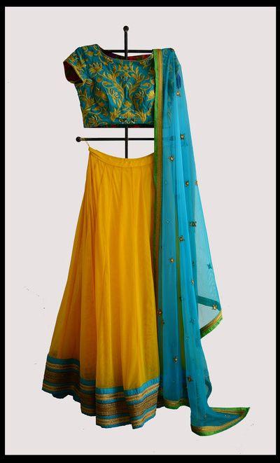 Turquoise & Yellow Lehenga | WedMeGood Gorgeous Turquoise Lehenga with Yellow Embroidery, Yellow Georgette Lehenga with Turquoise Border and Turquoise Net Dupatta #wedmegood #lehenga