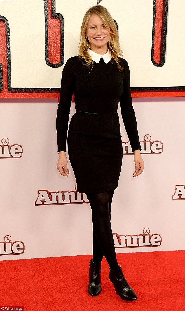 Looking glam: The Annie star donned a crisp, black and white look on the red carpet in Decmber last year