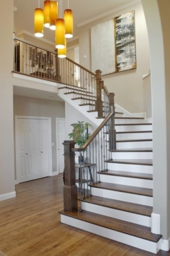 This Was Your Typical Suburban Staircase With Golden Oak Railings And  Balusters, And Carpeted Stair