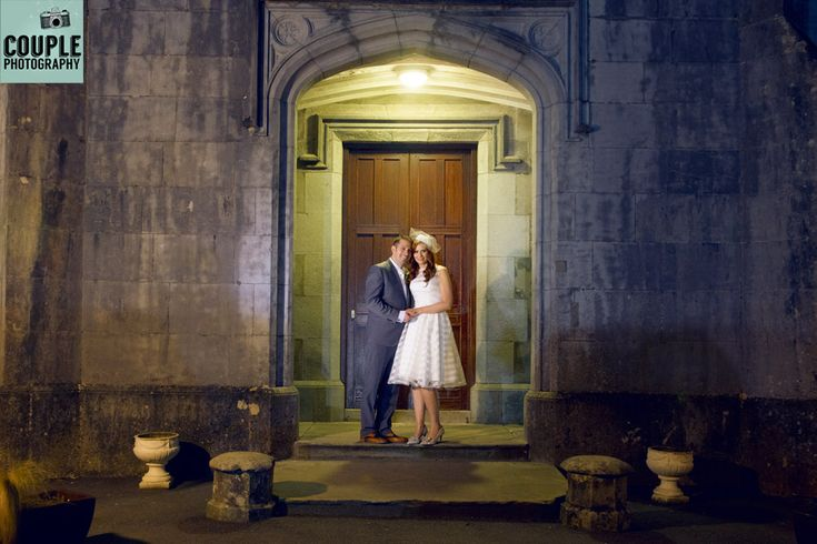 Night time photo of the Newlyweds in front of the castle at night. Photographed by a long exposure allowing the light to glow from the castle. Weddings at Kinnitty Castle photographed by Couple Photography.
