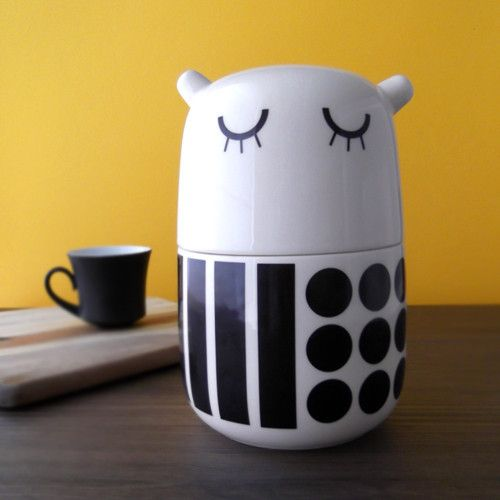 """She is made from cream-colored clay (called """"creamware"""") and dipped in transparent glaze. #camilaprada #cute #adorable #creatures #tableware #dots #stripes #blackandwhite"""