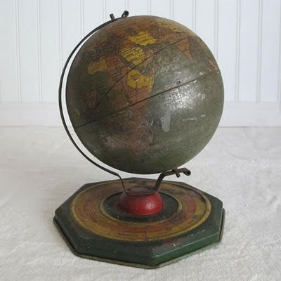 Grand metal school globe with a zodiac base.  Very special and most vintage.