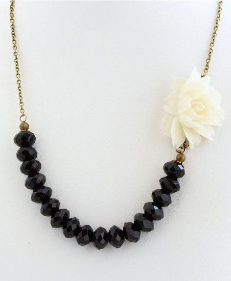 Stone beads in front with side accent piece (Flower Necklace, Black and White)