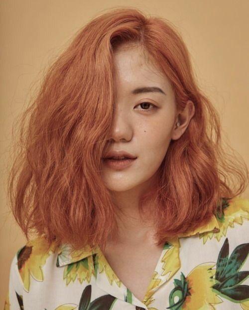 Soft orange hair , lemon shirt , brown eyes , short hair
