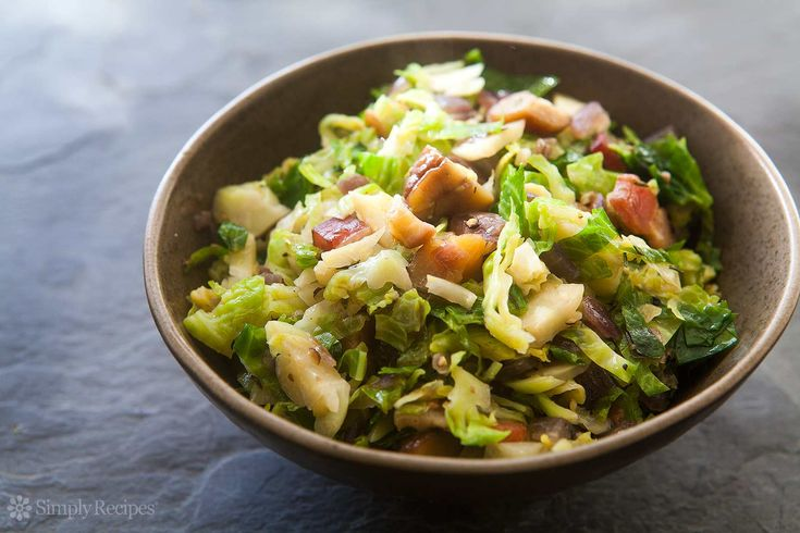 Brussels Sprouts with Bacon and Chestnuts ~ Thinly sliced brussels sprouts sauteed with bacon and onions, then tossed with roasted chestnuts, thyme and a little lemon juice. ~ SimplyRecipes.com